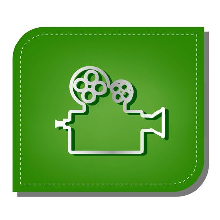 Retro video recording camera sign. Silver gradient line icon with dark green shadow at ecological patched green leaf.