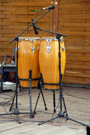 bongos: two bongos made of wood and leather