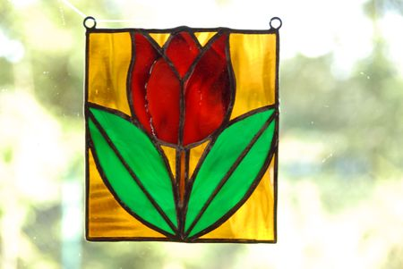 Stained glass vitrage with colourful glass on the window photo