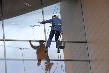 rapelling: Windows cleaner in the city of Gdansk in Poland