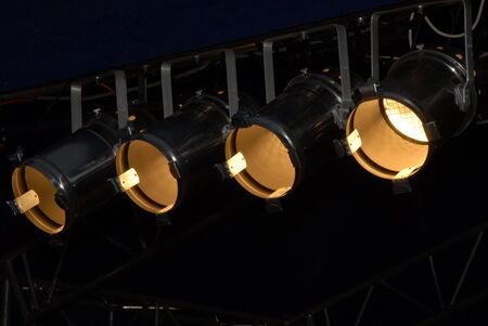 lighting system: Stage lighting system under roof. Spotlights, outdoor theater. Stock Photo