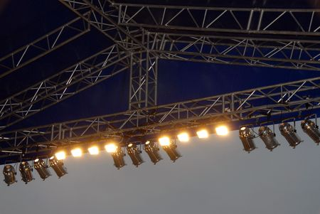 lighting system: Stage lighting system under roof and sky. Spotlights, outdoor theater.