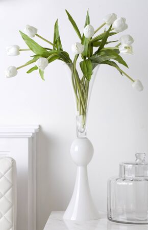 glass vase:  Bunch off white tulip in white glass vase Stock Photo