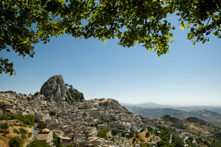 Old sicilian mountain village Caltabellotta with the huge rock which is a viewpoint.  Stock Photo