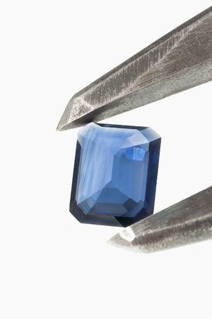 topaz: Blue topaz gem in caliper isolated with copy space