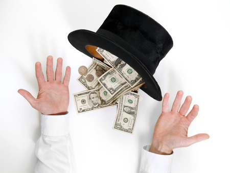 Businessman conjure a lot of dollars from an old black hat isolated on white background  photo