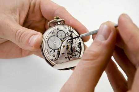 watchmaker: Watchmaker holding antique pocket watch show the clockwork mechanism and repair with screwdriver. Stock Photo