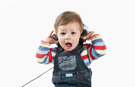 12 18 months: Baby with headphone,isolated on a white background