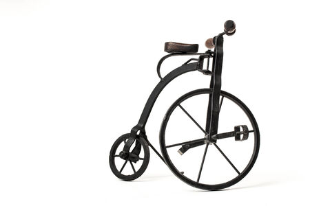 velocipede: vintage toy velocipede isolated in white  Stock Photo
