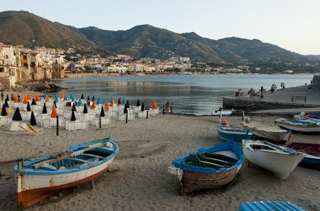 Rowboats on the beach of Cefalu, Italy photo