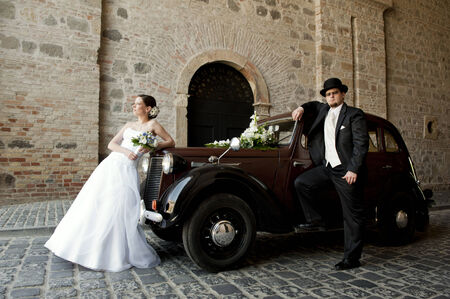 Wedding couple with old car photo
