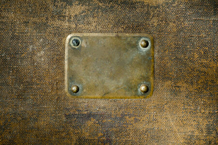 Rusty copper name plate on wood background. photo