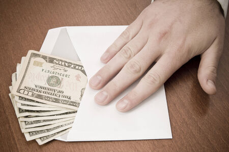 corruptible: Corruption concept. Business man take a stack of money in envelope isolated on white, clipping path included.