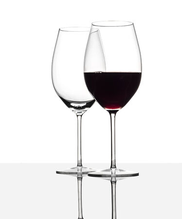 christal: Red wine glasses  One with red wine, one is empty  with reflection, isolated on white
