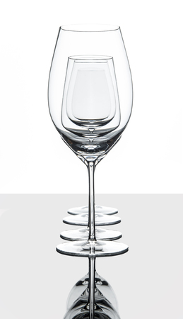 christal: Empty red and white wine glasses set behind each other isolated on white with reflection