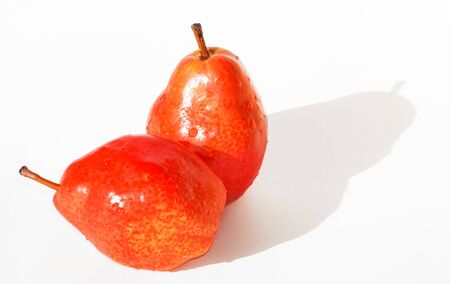 Two red pear isolated on white background