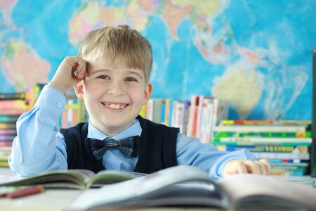 dreaminess: Portrait of smiling schoolboy