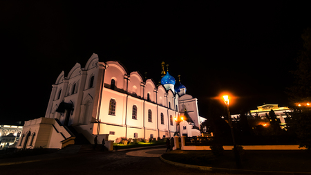 White Blagoveshchensky cathedral with blue cupola glowing in night, Kazan.