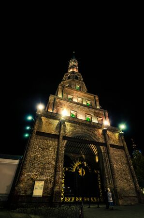 tatarstan: From below shot of old brick Syuyumbike tower illuminated with lanterns in city of Kazan. Stock Photo