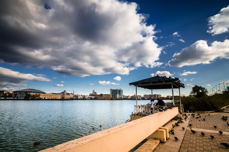 Terrace with concrete fence on background of Bottom boar lake in Kazan.