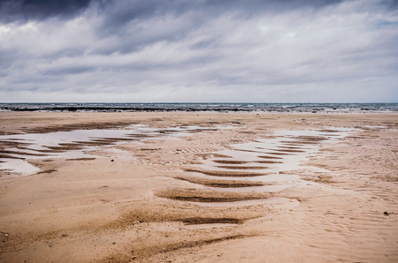 Long sandy beach in low tide with no water, Karon beach. 写真素材