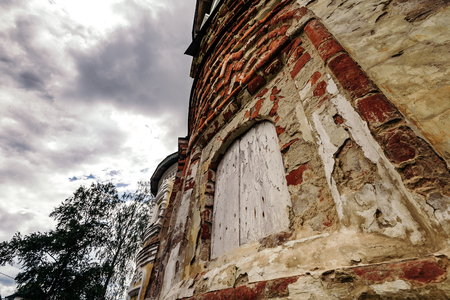 Grungy old wall of Church of the Nativity of St. John the Baptist in Uglich from below.