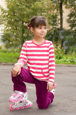 rollerskates: Little girl portrait summer outdoors on the roller-skates