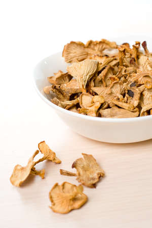 Dried mushrooms of chanterelle or girolle simple food composition Stock Photo