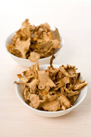 consist: Dried mushrooms of chanterelle or girolle simple food composition Stock Photo