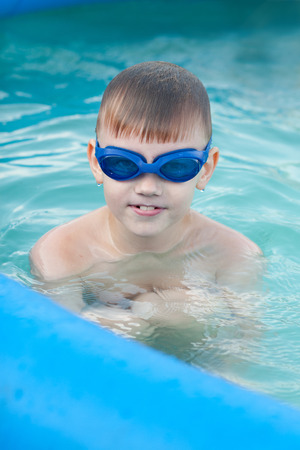 Boy in the pool having fun portrait