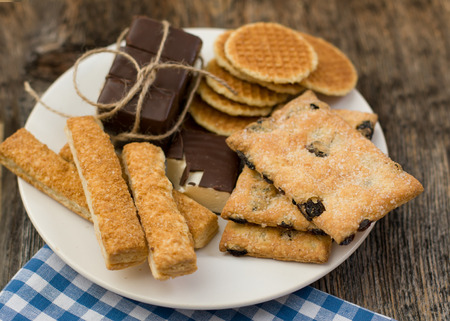 white backing: Cookies assortment on the dish Stock Photo
