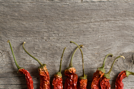racy: The dried peppers closeup on the wood composition