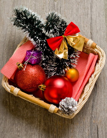 Little New year tree toys in the box on the wood backing closeup Stock Photo