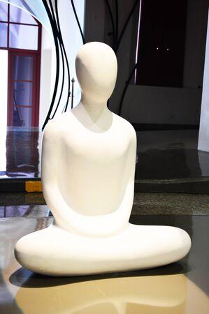 dhamma: the statue man sit crosslegs.