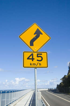a traffic sign indicating 45km/h speed zone on bends Stock Photo - 507400