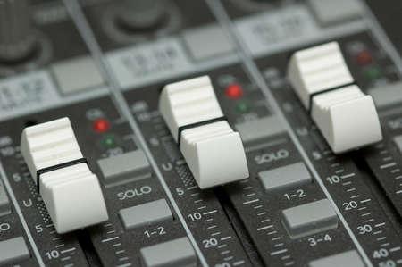 closeup view of a DJs mixing desk photo