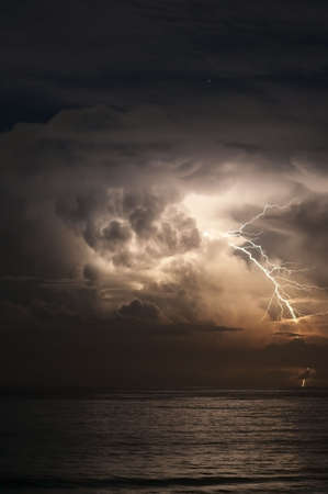 Brilliant forked lightning over the ocean Stock Photo - 4482365