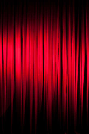 deliberate: A red velvet stage curtain with deliberate vignetting.    Part of a series
