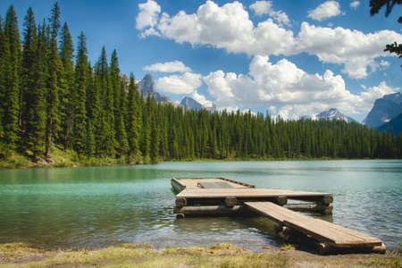 coniferous forest: Boating Dock Landscape Stock Photo
