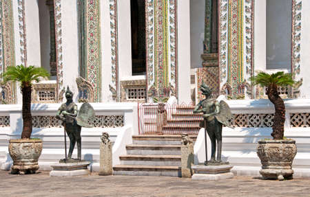 mythic bird creatures defend a buddhist temple