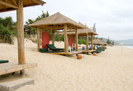 bamboo cabanas on beach at luxurious resort