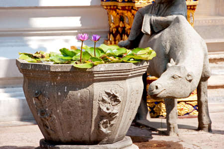 stone urn and sculpture at buddhist temple