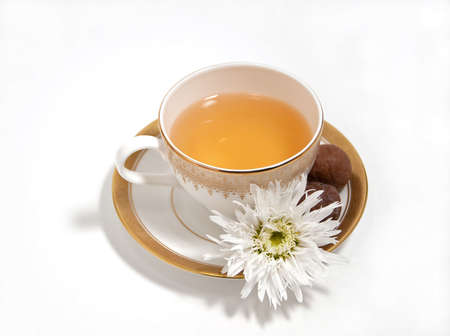 tea with chocolate truffles and white daisy