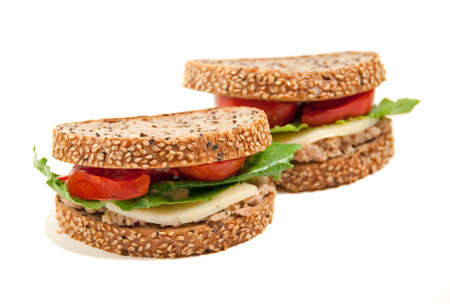 wholewheat sesame seed sandwiches isolated on white