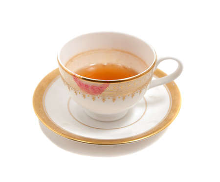 stained teacup with lipstick smear isolated on white