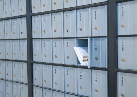 mail waiting in the u.s. gray/blue post office box Stock Photo - 5455039
