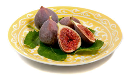 a plate of figs on a fig leaf Stock Photo
