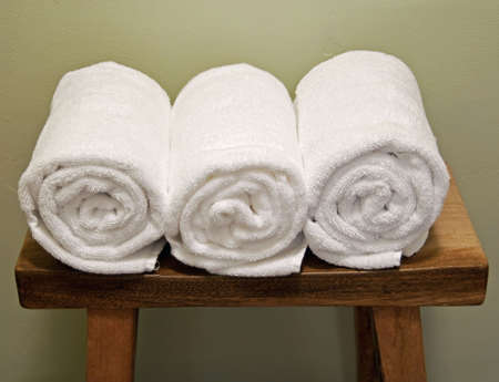 clean rolls of towels on a bench