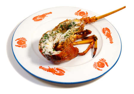 baked lobster on a plate with shellfish patterns