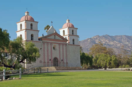 a panoramic view of mission santa barbara against the santa ynez mountains